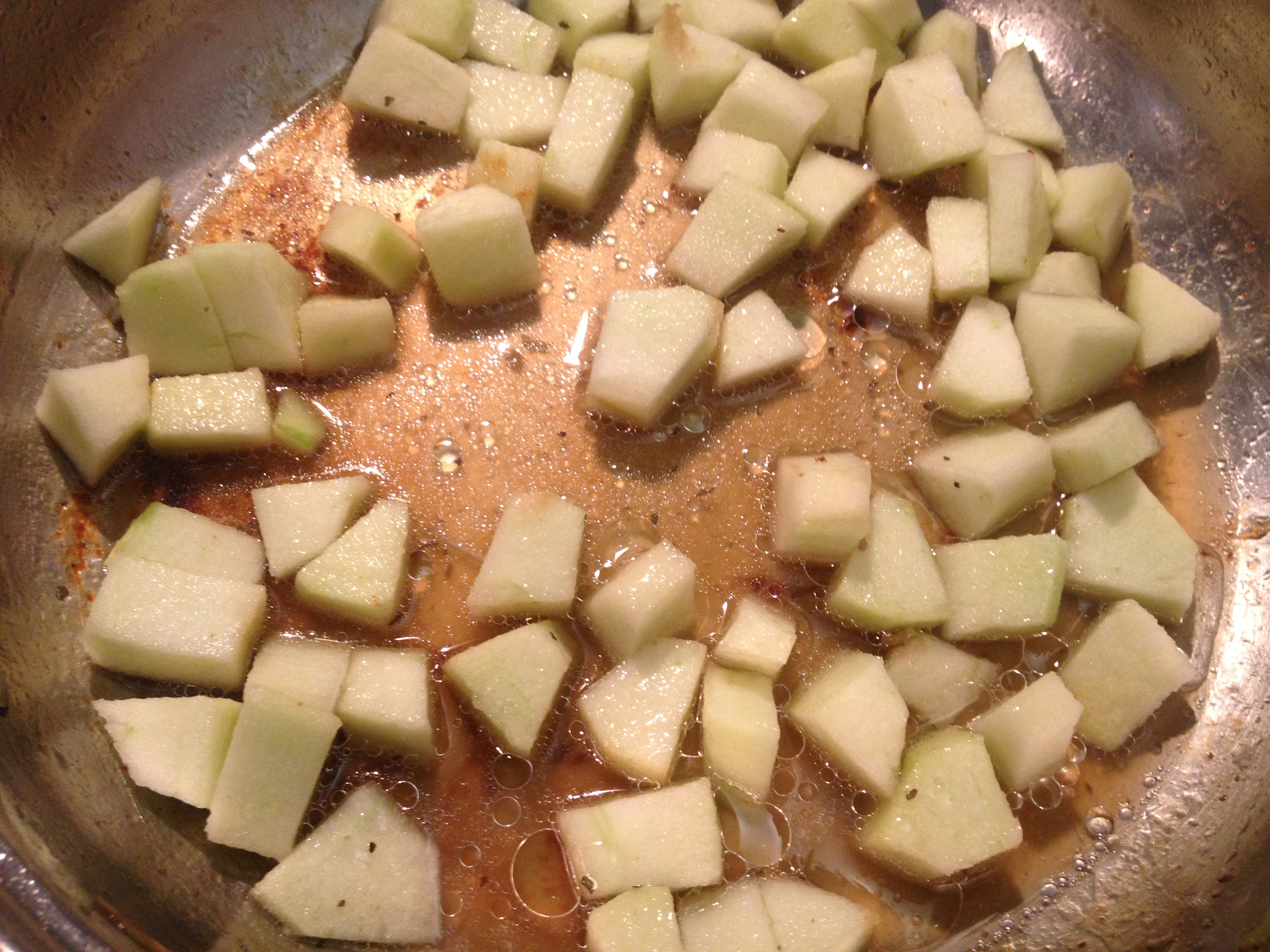 Sauteeing apples and molasses.