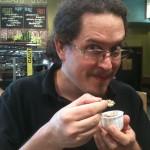 Brandon Pierce tasting the Pinapple Mango Salsa