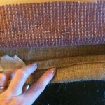 Fold over edges of burlap before stapling